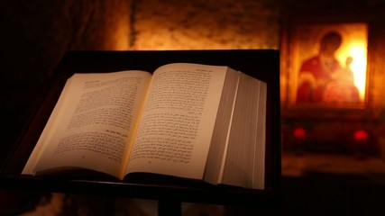 Holy Bible inside old church, air flips a page