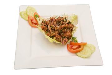 Thai spicy Tuna  salad on white plate