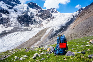 Big backpack on a background of mountains