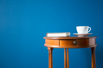 Coffee table isolated on blue