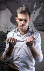 A man in a white shirt and tie breaks the chain.