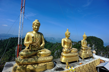 buddha statue at mountain peak