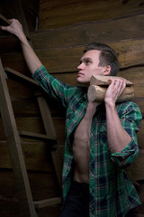 Man with firewood in the hands of climbing stairs