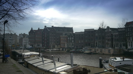 Canal with floating houseboats. Amsterdam, The Netherlands