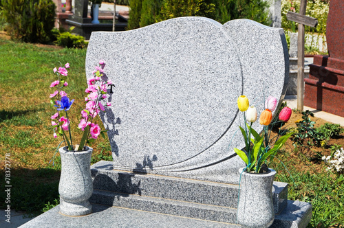 Tombstone in the cemetery - 78372778