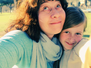 Funny selfie portrait mother and daughter outdoors
