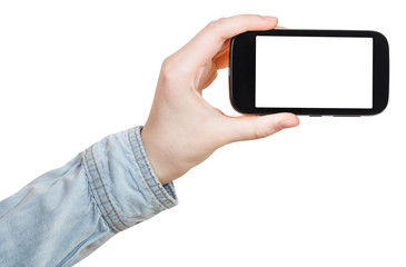 hand in shirt holds smartphone isolated