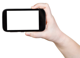child holds touchscreen phone with cut out screen