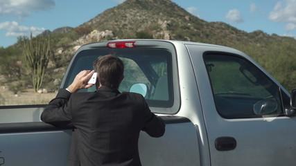 Businessman Against Truck Cellular Back