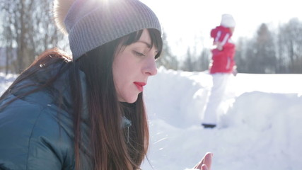 Girl applies lipstick