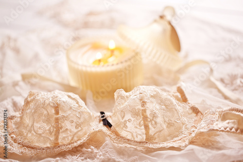 Tenderness peachys lingerie with candle and motif. Love mood. - 78375174