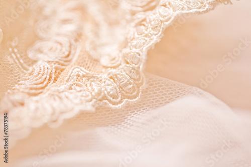 Leinwandbild Motiv Tenderness peachys lingerie with candle and motif. Love mood.