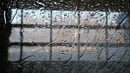 The car is in a car wash. View from the interior.