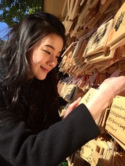 woman hanking wood tablet in tokyo