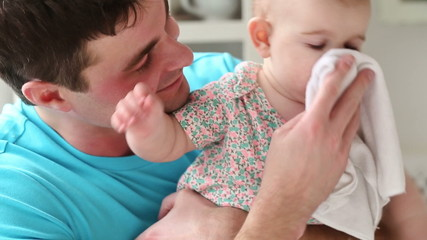 young dad takes care of the baby and kisses him