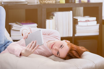 girl with tablet in the room