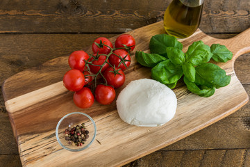 Cherry tomatoes and mozzarella cheese with basil
