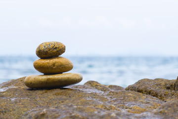 Stack of stones with sea background