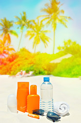 Sun protection cream on palm beach background. Tropical lanscape