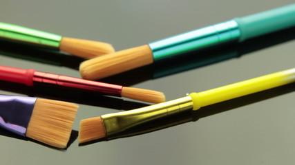 colorful paintbrush on black tracking