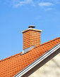 canvas print picture - Smoke stack on the roof of a building