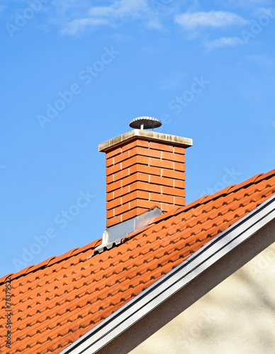 canvas print picture Smoke stack on the roof of a building