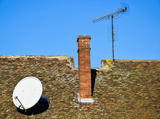 Antennas on the roof of an old building