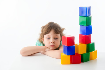 Little girl with cubes