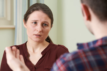 Depressed Young Woman Talking To Counsellor