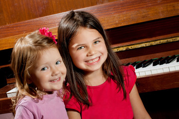 Little girl playing on piano