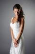 Thoughtful bride in elegant wedding dress
