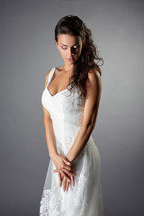 Thoughtful bride in elegant wedding dress
