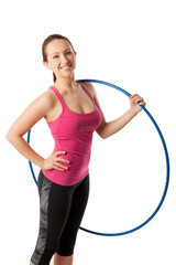 Closeup of young woman standing with hula hoop on her shoulder