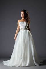 Beautiful girl in luxurious wedding dress