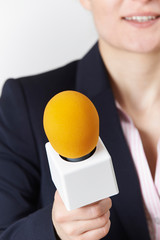 Abstract Shot Of Female Journalist With Microphone