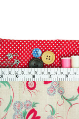 Sewing kit with fabric bag on white