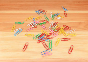 Multi-coloured paper clips scattered