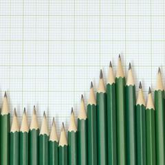 Pencils arrangement in pattern of graph on graph sheet.