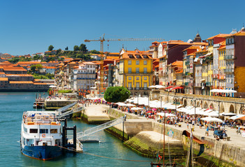 The Douro River and Colorful facades of old houses on embankment