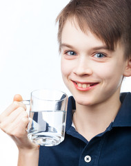 Kid with cup of water