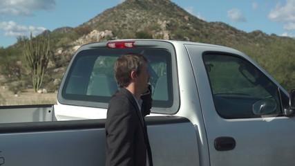 Businessman Against Truck Cellular Face