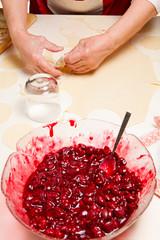 Cooking ukrainian varenyky with cherries. Serie.