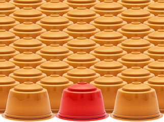 Coffee capsules, one red against set
