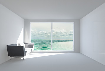 empty white room with sofa, window and view of ocean.