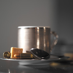 Coffee Cup and Bullets