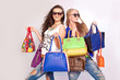 Two fashion girls and many different shopping bags in hands - 78388728