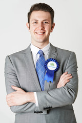 Portrait Of Conservative Politician Wearing Blue Rosette