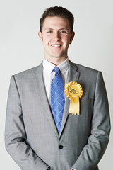 Portrait Of Liberal Democrat Politician Wearing Yellow Rosette