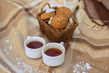 Two cups of tea with  cookies