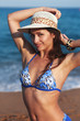 Beautiful bikini woman with epilation armpit on blue sea